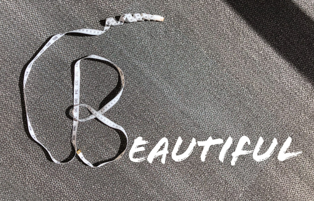 """Letter """"B"""" made with a measuring tape. The rest of the word """"beautiful"""" spelt out win letters."""