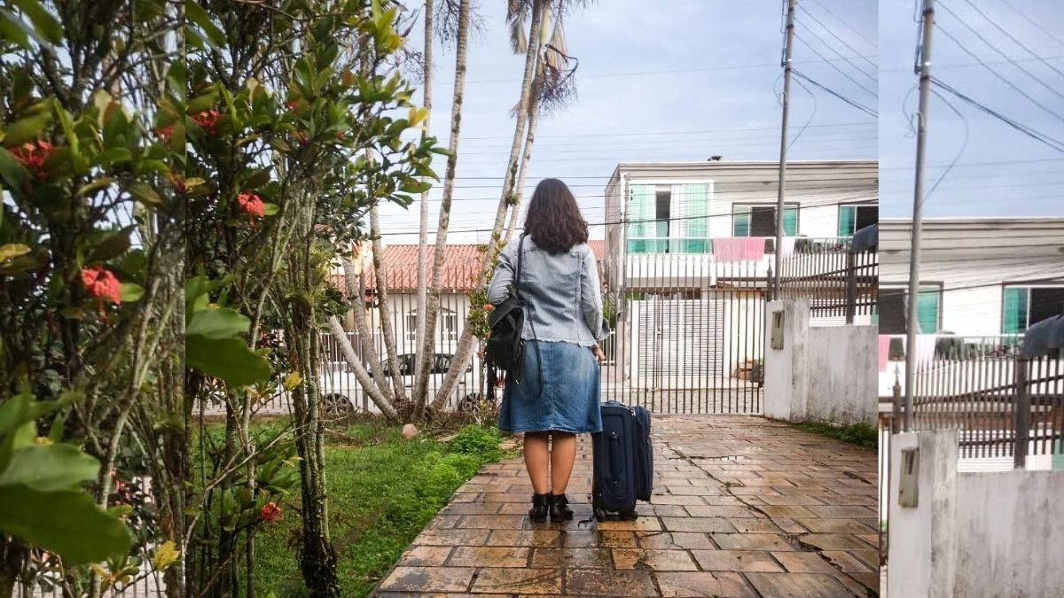 woman with suitcase leaving